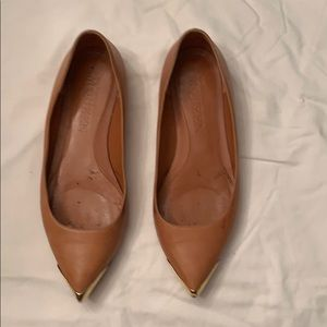 Alexander McQueen gold tipped leather flats